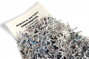 Confidential Document Partially Shredded Next to Paper Shreds