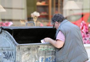Man digging into a bin