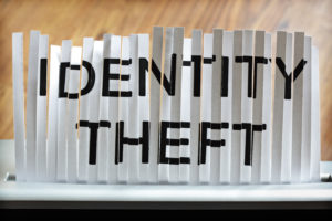 Identity theft Written on Shredded Paper
