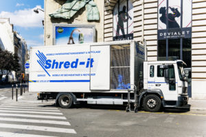 Shred-it truck Parked On Street In Front of A Building